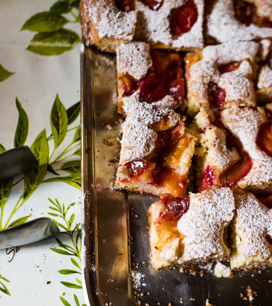 Freshly baked dessert with red and yellow jelly and powdered sugar