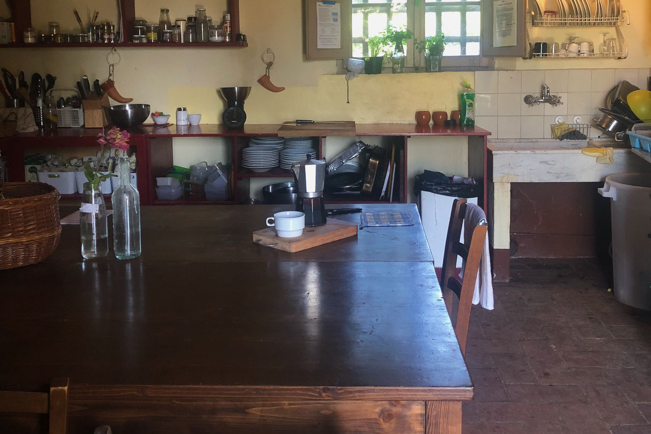 Brown wood dining table in the farm intern kitchen.